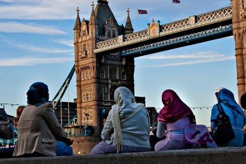 Muslim women look at Tower Bridge in London