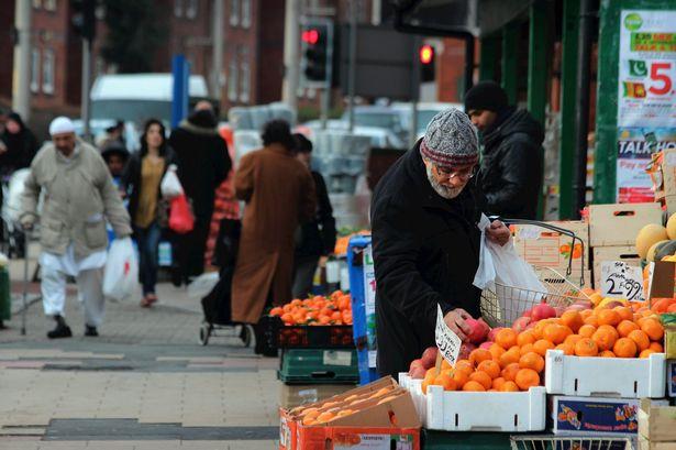 Pakistani man buying fruit on Cheetham Hill