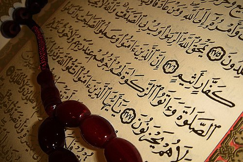 image of Quran with black prayer beads