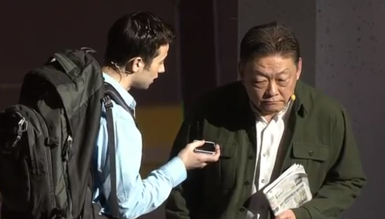 Chinese and American man use translation app to speak